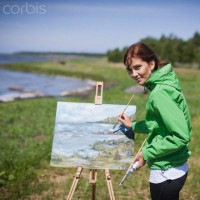 Woman painting lake